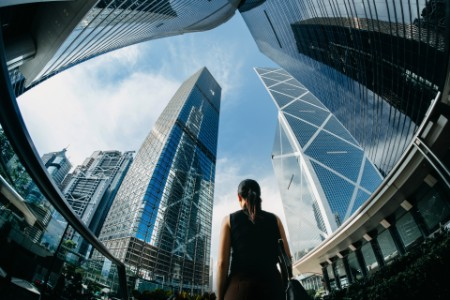 Woman looking at the skyscrapers