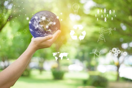 Human hand is holding World on green, save earth concept. element furnished by NASA